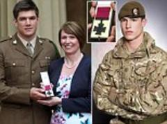 Ultimate tribute to a selfless hero: Parents of British soldier killed while protecting his comrades in Afghanistan accept his posthumous Victoria Cross from the Queen