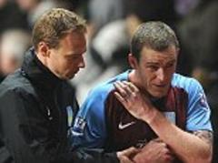 aston villa defender richard dunne told to find a new club by boss paul lambert