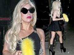 Lady Gaga staggers out in her signature high heels after recovering from hip operation